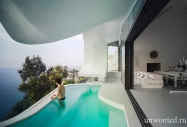 Необычный дом в скале Casa Del Acantilado - бассейн на террасе