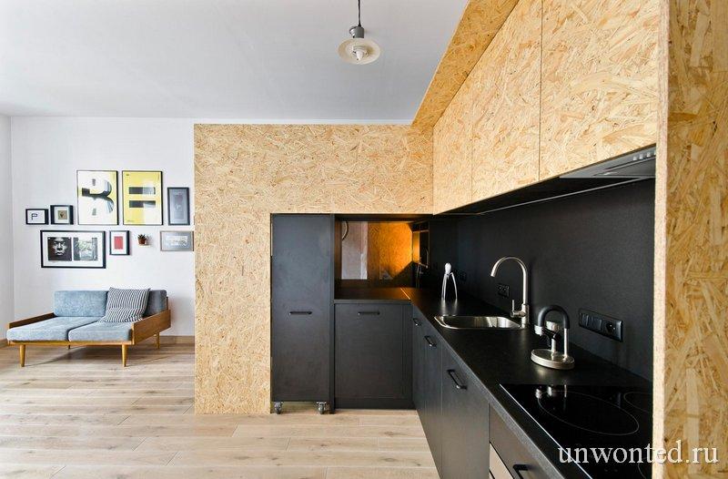 Черная кухня в квартире студии Brandburg home & studio